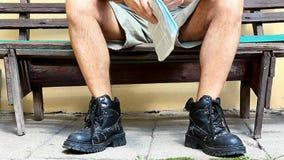 Читатель на стенде Стоковые Фото