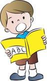 Чтение мальчика Стоковое Изображение