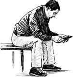 чтение человека Стоковая Фотография