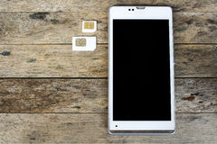 Что тип карточки sim может использовать на вашем передвижном, умном телефоне Стоковая Фотография RF