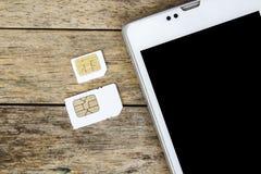 Что тип карточки sim может использовать на вашем передвижном, умном телефоне Стоковое фото RF