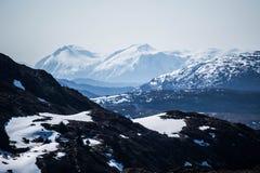 Что люди к утесам и горам? Стоковое фото RF