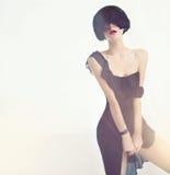 Чувственная дама в черном платье Стоковое Изображение