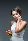 Чувственная молодая женщина с цветком Стоковая Фотография