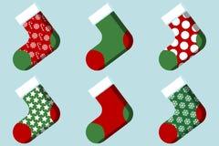 Чулок рождества с пакетом вектора картины плоским Иллюстрация вектора