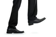 Шагать ноги бизнесмена стоковые фото