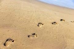 Шаги на песке Стоковые Изображения