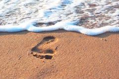 Шаг на spume песка и моря Стоковое Изображение