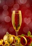 Шампань и роза красного цвета Стоковые Фотографии RF
