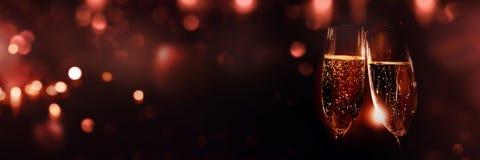 Шампань с красным bokeh стоковая фотография