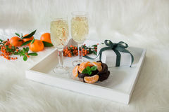 Шампань, шоколад, tangerines стоковые фото