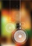 Шарики рождества вися на предпосылке bokeh Стоковое Изображение