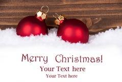Шарики рождества в снеге с космосом для вашего текста Стоковые Фото
