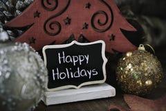 Шарики рождества и праздники текста счастливые стоковое изображение rf