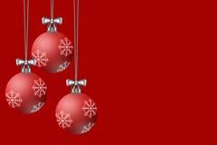 Шарики рождества показанные на красной предпосылке Стоковая Фотография