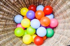 Шарики цвета в корзине Стоковая Фотография