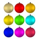 Шарики ` s Нового Года пестротканые на рождественской елке Стоковое Фото