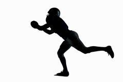 Шарик американского футболиста силуэта заразительный Стоковые Фото