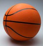 Шарик баскетбола на светлой предпосылке Стоковые Изображения RF