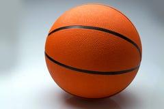 Шарик баскетбола на светлой предпосылке Стоковое Фото