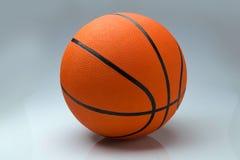 Шарик баскетбола на светлой предпосылке Стоковое фото RF
