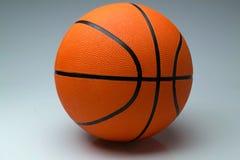 Шарик баскетбола на светлой предпосылке Стоковая Фотография RF