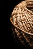 Шарик веревочки на черноте Стоковые Изображения