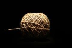 Шарик веревочки на черноте Стоковое Изображение
