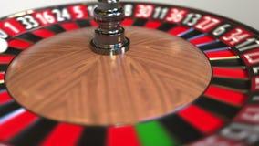 Шарик колеса рулетки казино ударяет 14 14 красного E иллюстрация штока