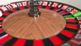 Шарик колеса рулетки казино ударяет 23 23 красных E иллюстрация штока