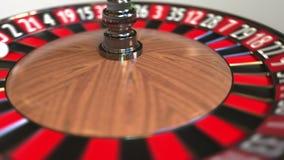 Шарик колеса рулетки казино ударяет 17 17 черных E иллюстрация вектора