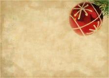 Шарик рождества над коричневой бумагой Стоковая Фотография