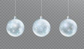Шарик рождества стеклянный прозрачный со снегом и заревом Установите украшений зимы бесплатная иллюстрация