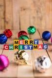Шарик рождества красный на деревянном поле jpg Стоковое Фото
