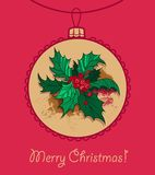 Шарик рождества с падубом рождества Стоковое Фото