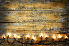 Шарик светов рождества на деревянной таблице Стоковая Фотография