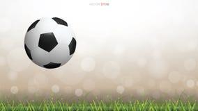 Шарик футбола футбола на поле зеленой травы с светом запачкал предпосылку bokeh бесплатная иллюстрация