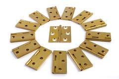 Шарниры для круга солнца цветка дверей Золотая латунь На белизне Стоковое Изображение RF
