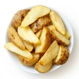 Шар зажаренных клин картошки на белизне От выше Стоковые Фотографии RF