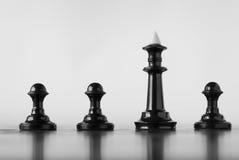 Шахматные фигуры на доске Стоковые Фото