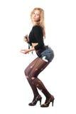 Шаловливая блондинка с бутылкой. Изолировано стоковое изображение