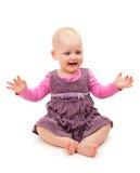 Шаловливый радостный ребенок сидит Стоковая Фотография RF