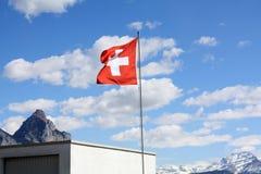 швейцарец флага небо предпосылки голубое Стоковые Фотографии RF