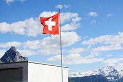 швейцарец флага небо предпосылки голубое Стоковое Фото