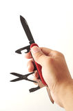 швейцарец человека ножа владением армии Стоковая Фотография RF