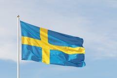 Шведские языки сигнализируют, синь и желтый крест Стоковые Изображения