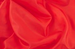 шелк красного цвета предпосылки Стоковое фото RF