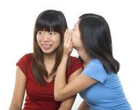 Шептать к уху Стоковая Фотография RF