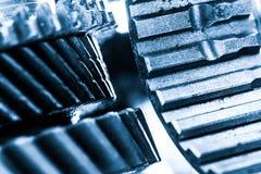 Шестерни, cogwheels grunge, реальный конец-вверх элементов двигателя Тяжелая индустрия Стоковые Изображения RF