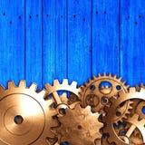 Шестерня металла на голубой деревенской деревянной доске meterial дизайн Стоковое Изображение RF